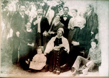 The Clark Family - taken about 1890 Seated right Godfrey John 1823-1899, seated cente his wife Standing left Edmund, Godfrey's 3rd son, 2nd left, Stanley Godfrey's 2nd son Seated left Holly, Edmunds wife. standind 2nd right Agnes, Stanley's wife.        Stanley's children, Frank standing right, Lewis standing 3rd from left, 2nd son  Percy sitting right front, 3rd son and Minnie siting front left 4th child   Edmunds       only child Ted, standing 3rd from right, missing Godfeys 1st son Lewis and his 4th son Alfred.