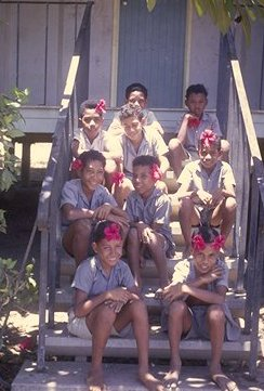 The boys from my class, most of them wearing hibiscus flowers.