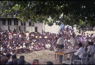 An outdoor assembly at Hagara Primary School,  no refinements such as a school hall there.